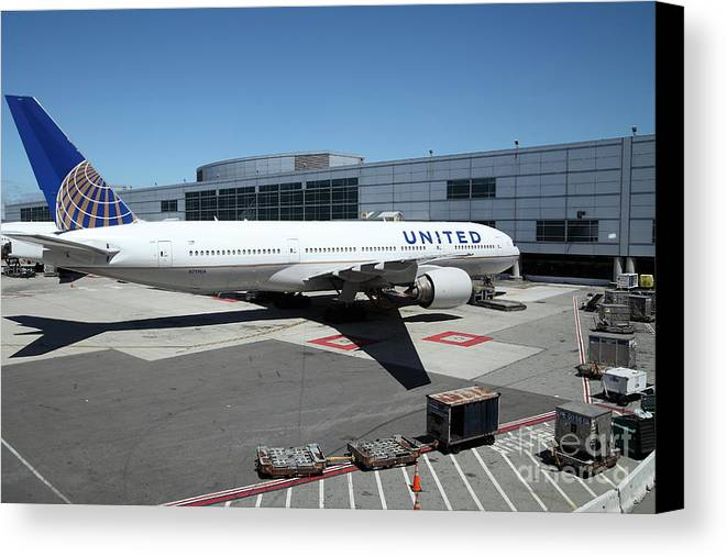 Transportation Canvas Print featuring the photograph United Airlines Jet Airplane At San Francisco Sfo International Airport - 5d17114 by Wingsdomain Art and Photography