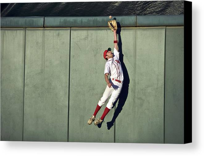 25-29 Years Canvas Print featuring the photograph Usa, California, San Bernardino, Baseball Player Making Leaping Catch At Wall by Donald Miralle