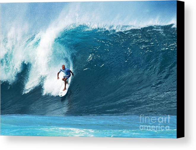 Kelly Slater Canvas Print featuring the photograph Pro Surfer Kelly Slater Surfing In The Pipeline Masters Contest by Paul Topp