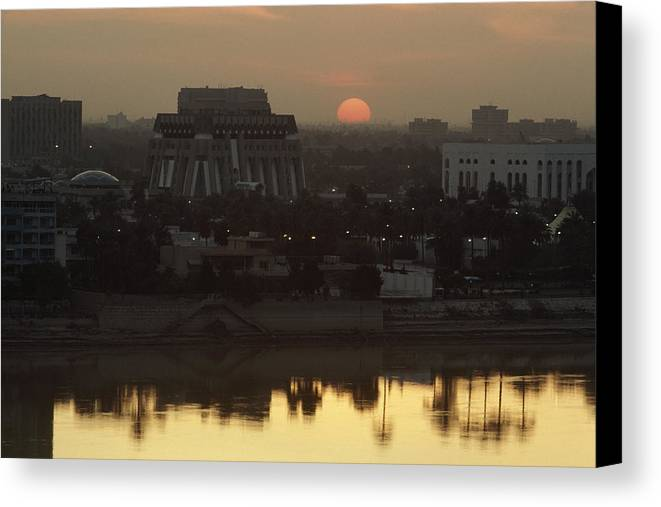 Sunset Canvas Print featuring the photograph Baghdad And The Tigris River At Sunset by Lynn Abercrombie