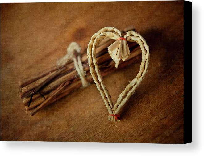 Horizontal Canvas Print featuring the photograph Braided Wicker Heart On Small Bundled Wood by Alexandre Fundone