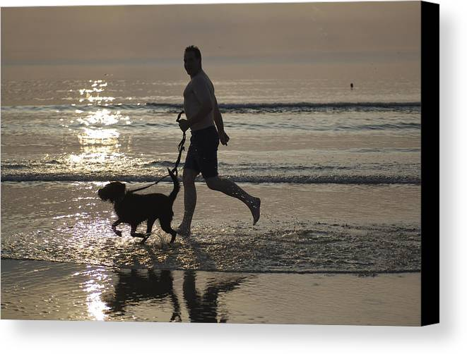 One Person Canvas Print featuring the photograph Denmark, Romo, Silhouette Of Man by Keenpress