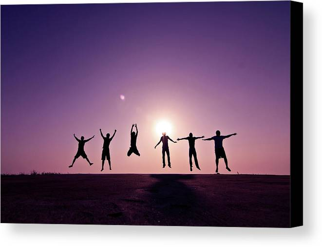Horizontal Canvas Print featuring the photograph Friends Jumping Against Sunset by Kazi Sudipto photography