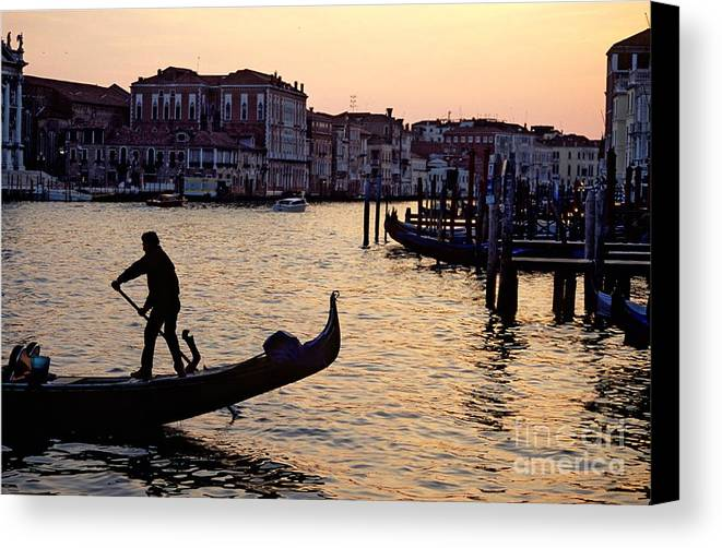 Venice Canvas Print featuring the photograph Gondolier In Venice In Silhouette by Michael Henderson