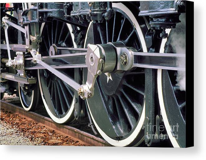 Coupling Rod Canvas Print featuring the photograph Steam Locomotive Coupling Rod And Driver Wheels by Wernher Krutein