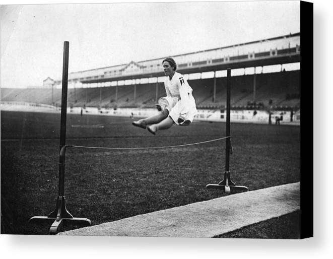 Mid Adult Canvas Print featuring the photograph Gymnastic Jump by Topical Press Agency