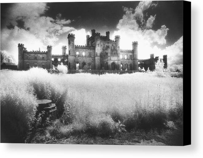 Castellated; Crenellated; Towers; Exterior; Architecture; English; Facade; Gothic; Ghostly; Atmospheric; Striking; Dramatic; Landscape; Eerie; Mysterious; Sinister Canvas Print featuring the photograph Lowther Castle by Simon Marsden