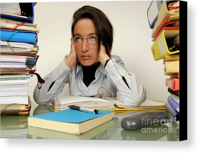Casual Clothing Canvas Print featuring the photograph Mature Office Worker Sitting At Desk With Piles Of Folders by Sami Sarkis