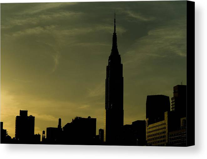 New York City Canvas Print featuring the photograph Silhouette Of Empire State Building by Todd Gipstein