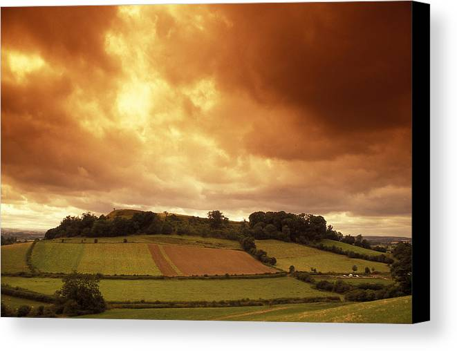 Clouds Canvas Print featuring the photograph Sunrise Over Ruins Of The Castle by Richard Nowitz