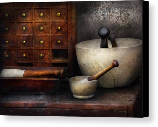 Suburbanscenes Canvas Print featuring the photograph Apothecary - Pestle And Drawers by Mike Savad