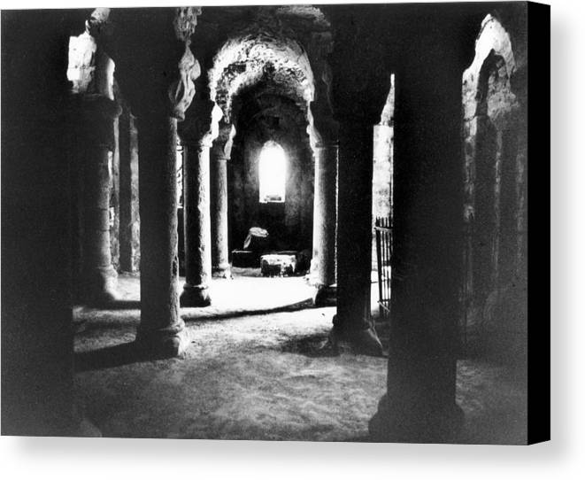 Interior; Architecture; French; Medieval; Gothic; Spooky; Eerie; Macabre; Barbe-bleue; Bluebeard's; Castle; Dungeon; Fairytale; Atmospheric; Vault; Vaulted; Columns; Pillars; Dark; Dramatic; Lair; History; Historical; Haunted Canvas Print featuring the photograph The Crypt by Simon Marsden