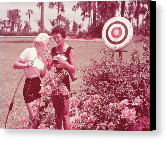 Adult Canvas Print featuring the photograph Women Holding Bow And Quiver By Target by Archive Holdings Inc.