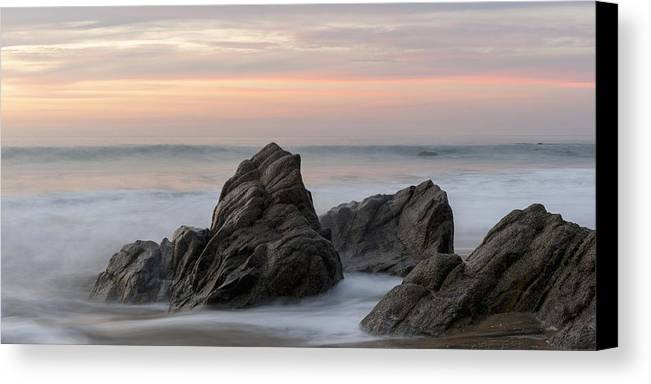 Beauty In Nature Canvas Print featuring the photograph Mist Surrounding Rocks In The Ocean by Keith Levit