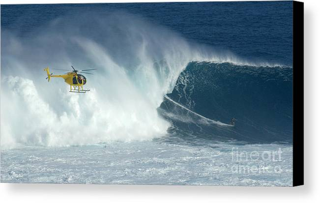 Laird Hamilton Canvas Print featuring the photograph Laird Hamilton Going Left At Jaws by Bob Christopher