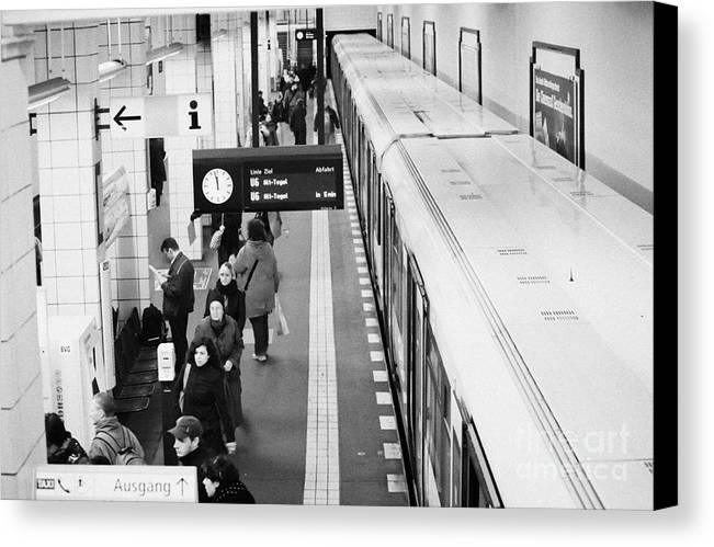Berlin Canvas Print featuring the photograph passengers along ubahn train platform Friedrichstrasse Friedrichstrasse u-bahn station Berlin by Joe Fox