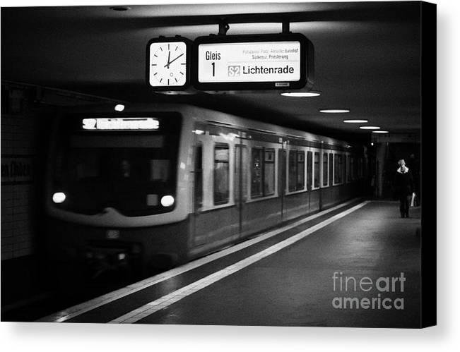 Berlin Canvas Print featuring the photograph s-bahn train speeding through unter den linden underground station Berlin Germany by Joe Fox
