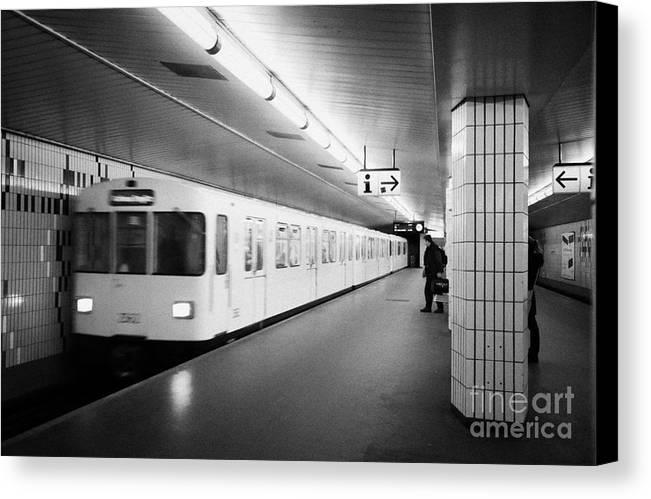 Berlin Canvas Print featuring the photograph u-bahn train pulling in to ubahn station Berlin Germany by Joe Fox