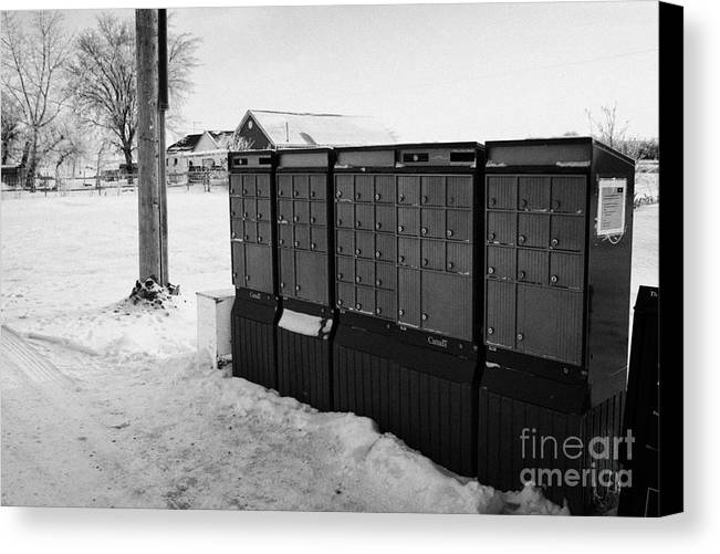 Canada Canvas Print featuring the photograph canada post post mailboxes in rural small town Forget Saskatchewan Canada by Joe Fox