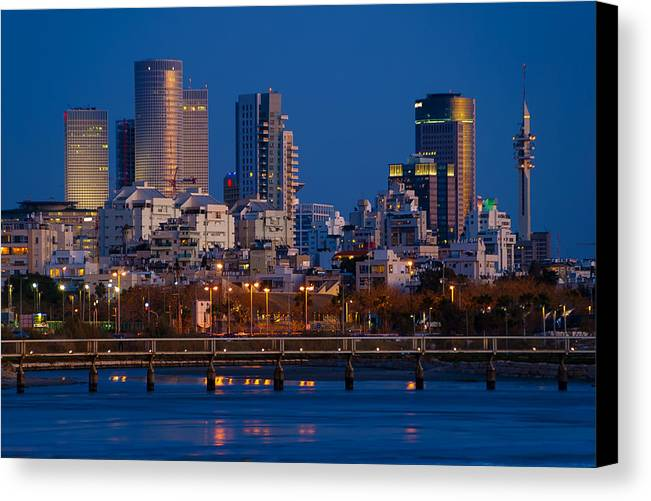 Kaballah Canvas Print featuring the photograph city lights and blue hour at Tel Aviv by Ron Shoshani