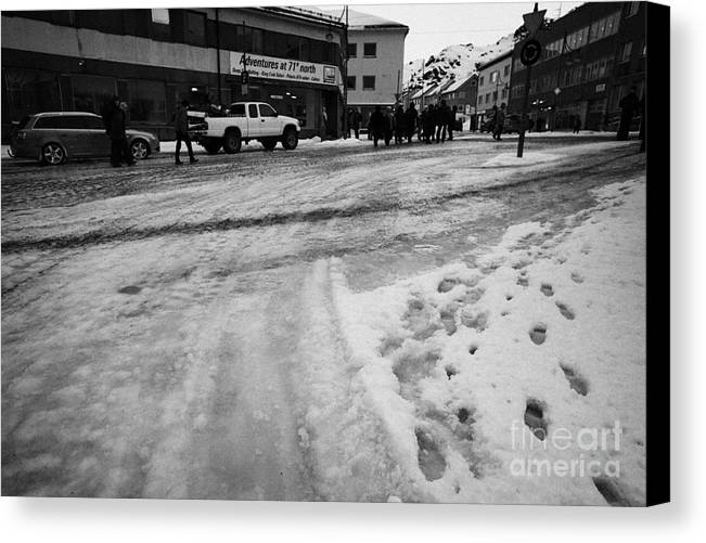 Melting Canvas Print featuring the photograph melting ice and snow on street surface holmen Honningsvag finnmark norway europe by Joe Fox