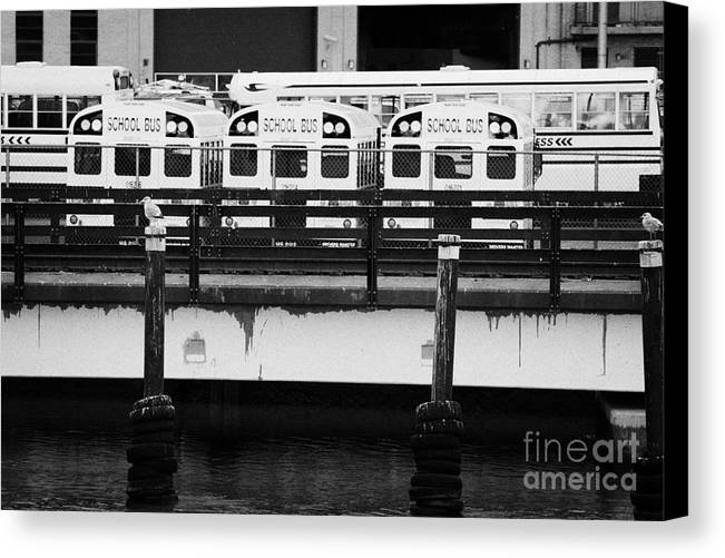 Usa Canvas Print featuring the photograph Yellow School Buses In A Car Park New York City by Joe Fox
