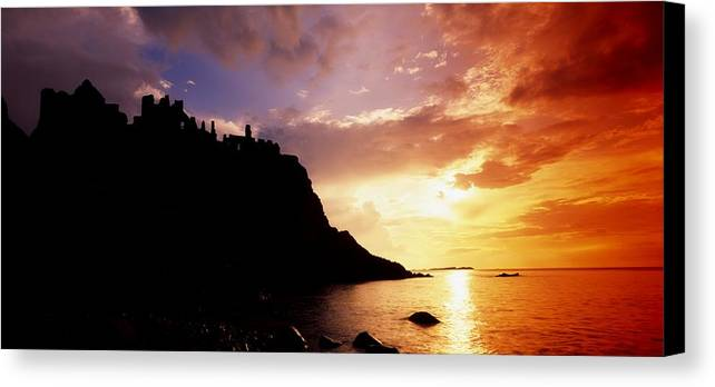 Antrim Canvas Print featuring the photograph Dunluce Castle, Co Antrim, Ireland by The Irish Image Collection
