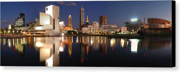 Cleveland Skyline Canvas Print featuring the photograph Cleveland Skyline At Dusk by Jon Holiday
