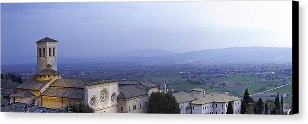 Italy Canvas Print featuring the photograph Panoramic View Of Assisi At Night by Susan Schmitz