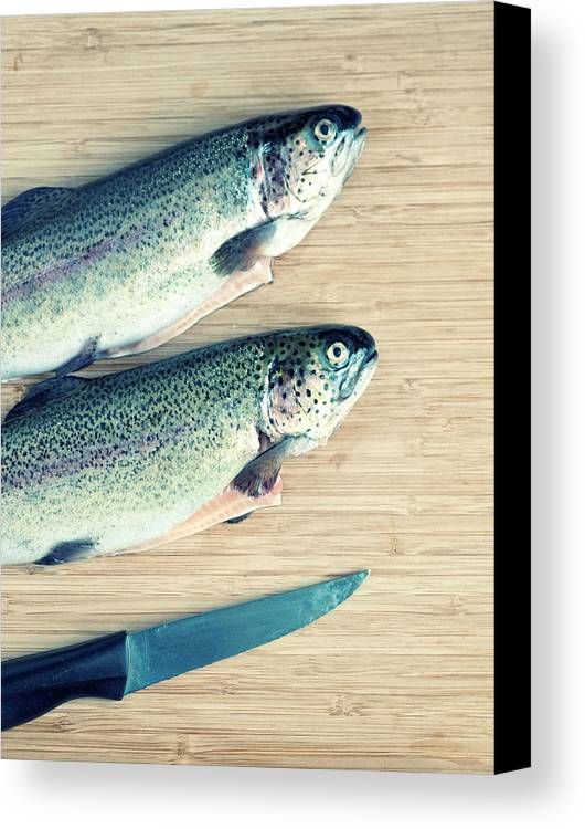 Vertical Canvas Print featuring the photograph Trouts by Carlo A
