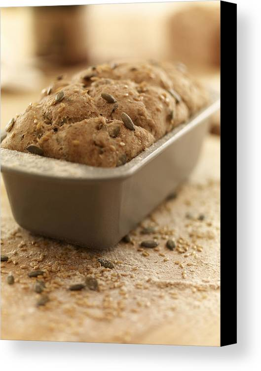 Vertical Canvas Print featuring the photograph Close Up Of Rustic Bread In Loaf Pan by Adam Gault