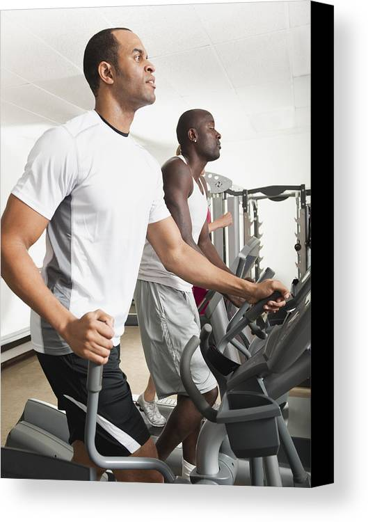 30-34 Years Canvas Print featuring the photograph People Exercising In Health Club by Erik Isakson