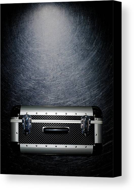 Vertical Canvas Print featuring the photograph Protective Luggage Case On Stainless Steel. by Ballyscanlon
