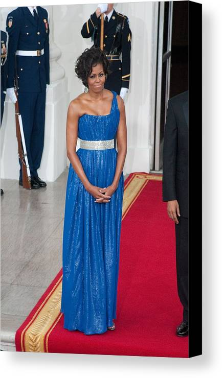 First Lady Michelle Obama Canvas Print featuring the photograph First Lady Michelle Obama Wearing by Everett