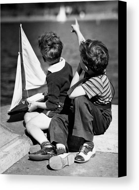 Child Canvas Print featuring the photograph Two Boys Playing W/sailboats by George Marks