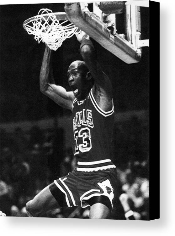 Classic Canvas Print featuring the photograph Michael Jordan Dunks by Retro Images Archive