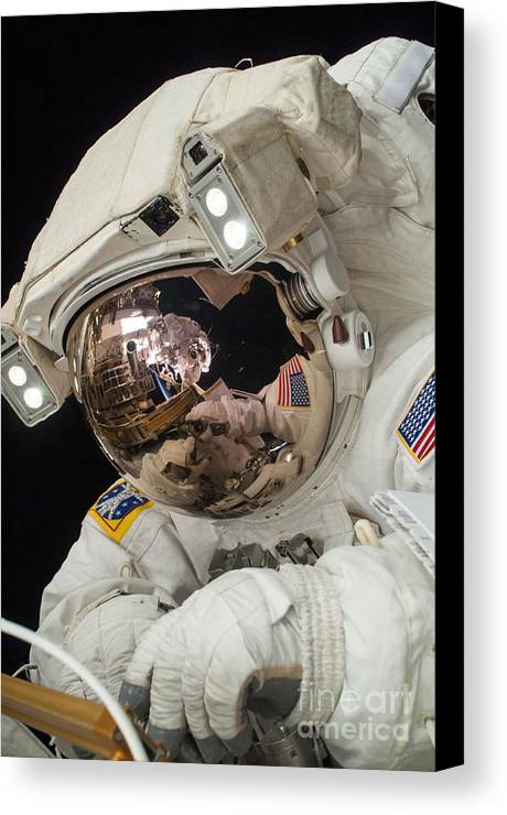 Space Canvas Print featuring the photograph Iss Expedition 38 Spacewalk by Science Source