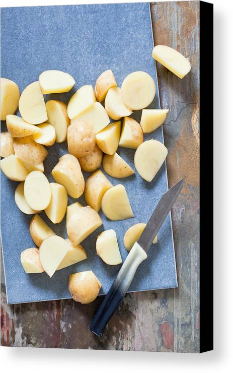 Board Canvas Print featuring the photograph Potatoes by Tom Gowanlock