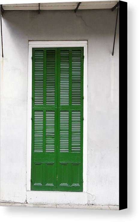Front Canvas Print featuring the photograph A Green Door In New Orleans by Christine Till