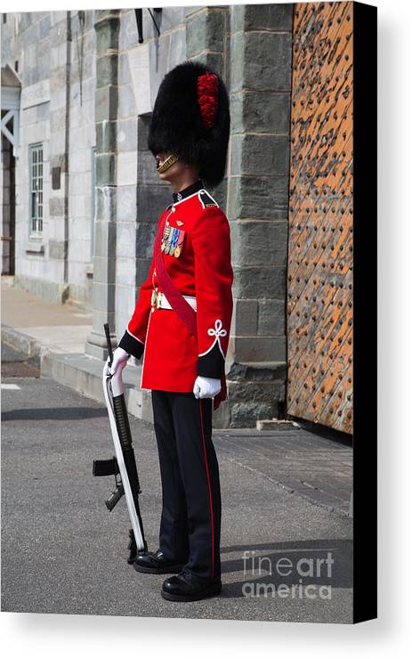 Quebec Canvas Print featuring the photograph On Guard Quebec City by Edward Fielding