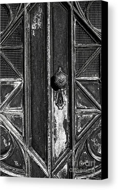 Aged Canvas Print featuring the photograph The Key Hole by Darren Fisher