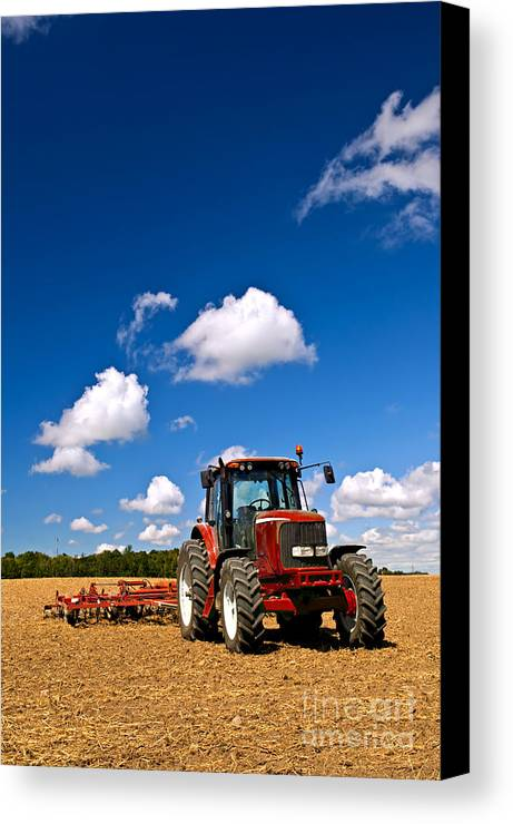 Tractor Canvas Print featuring the photograph Tractor In Plowed Field by Elena Elisseeva