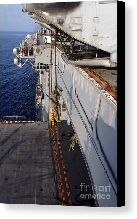 Aircraft Canvas Print featuring the photograph Marines And Sailors Fast-rope by Stocktrek Images