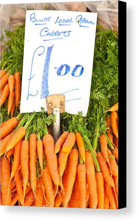 Carrots Canvas Print featuring the photograph Carrots by Tom Gowanlock