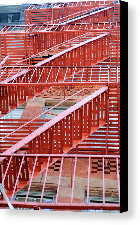 Vertical Canvas Print featuring the photograph Fire Escape by Copyright Eric Reichbaum