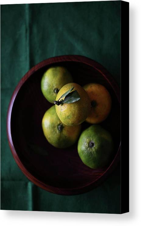Vertical Canvas Print featuring the photograph Mandarin Orange In Wooden Bowl by © Miss Snail All right reserved