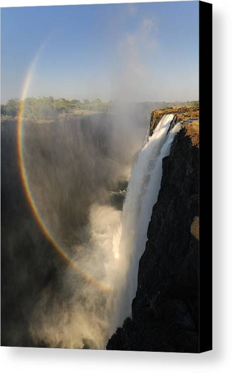 Rainbow At The Victoria Falls Canvas Print featuring the photograph Victoria Falls by Christian Heeb
