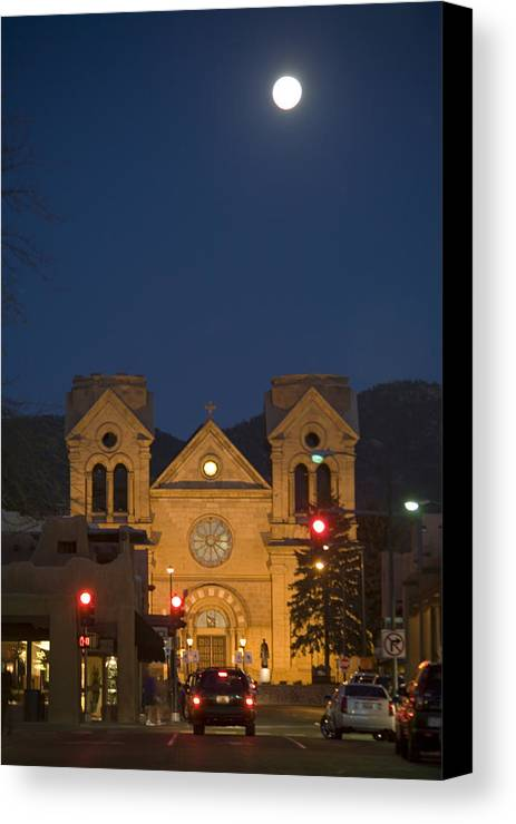New Mexico Canvas Print featuring the photograph A Full Moon Rises Over Cathedral by Stephen St. John