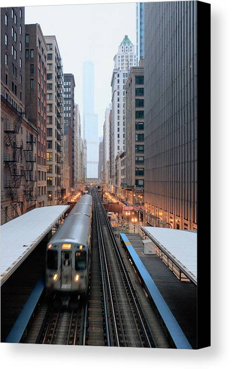 Vertical Canvas Print featuring the photograph Elevated Commuter Train In Chicago Loop by Photo by John Crouch