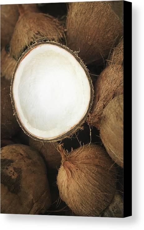 Arrange Canvas Print featuring the photograph Half Coconut by Brandon Tabiolo - Printscapes